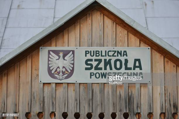 A view of a 'Public universal school' sign at the entrance to the wooden school building inside the Folk Culture OpenAir Museum in Kolbuszowa On...