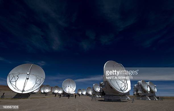View of a Radio telescope antennas of the ALMA project in the Chajnantor plateau Atacama desert some 1500 km north of Santiago on March 122013 The...