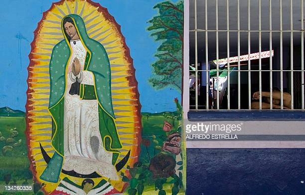 View of a religious image painted on a wall at the Female Penitentiary in Culiacan Sinaloa State Mexico on November 24 2011 As drug gangs multiply...