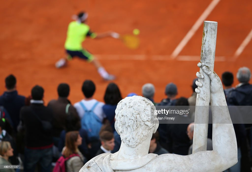 A view of a Roman statue as Marco Cecchinato of Italy plays a foreand in is match against <a gi-track='captionPersonalityLinkClicked' href=/galleries/search?phrase=Igor+Sijsling&family=editorial&specificpeople=878881 ng-click='$event.stopPropagation()'>Igor Sijsling</a> of Holland during day three of the Internazionali BNL d'Italia tennis 2014 on May 13, 2014 in Rome, Italy.