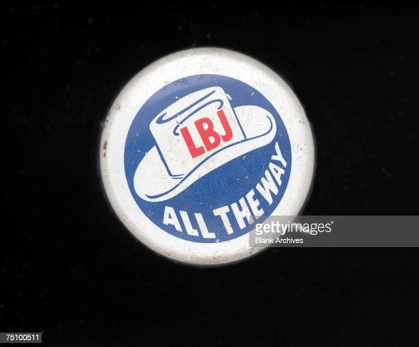 View of a round campaign button in support of Lyndon Baines Johson's presidential candidacy 1964 The botton shows a white hat on a blue field...