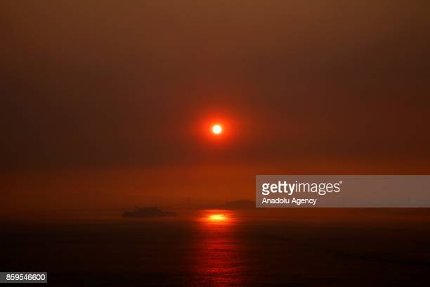 A view of a San Francisco gulf as smoke covers the sun as a wildfire from the Santa Rosa and Napa Valley moves through the area in California United...