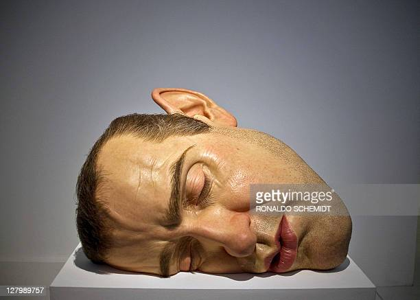 View of a sculpture entitled 'Mask II' by Australian hyperrealist sculptor Ron Mueck at the San Ildefonso Museum in Mexico City on October 4 2011 The...