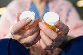 Woman holding pill bottles