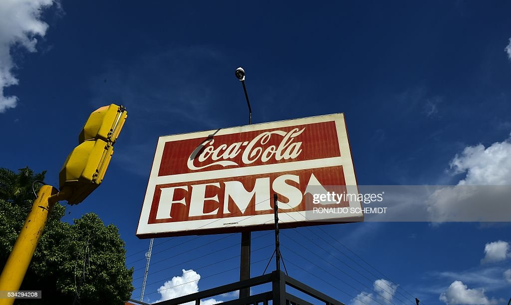 View of a sign of Coca-Cola at a distribution plant in Caracas, on May 25, 2016. Coca Cola suspended much of its distribution in Venezuela due to the lack of sugar. / AFP / RONALDO