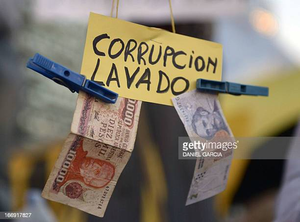 View of a sign reading 'Corruption laundering' during a protest against the government of Argentine President Cristina Fernandez de Kirchner near the...