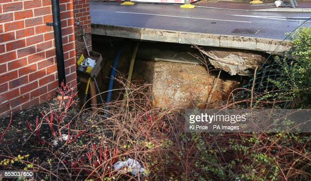 A view of a sinkhole in Oatridge Gardens Hemel Hempstead approximately 35ft wide and 20ft deep which appeared under part of a home and the road