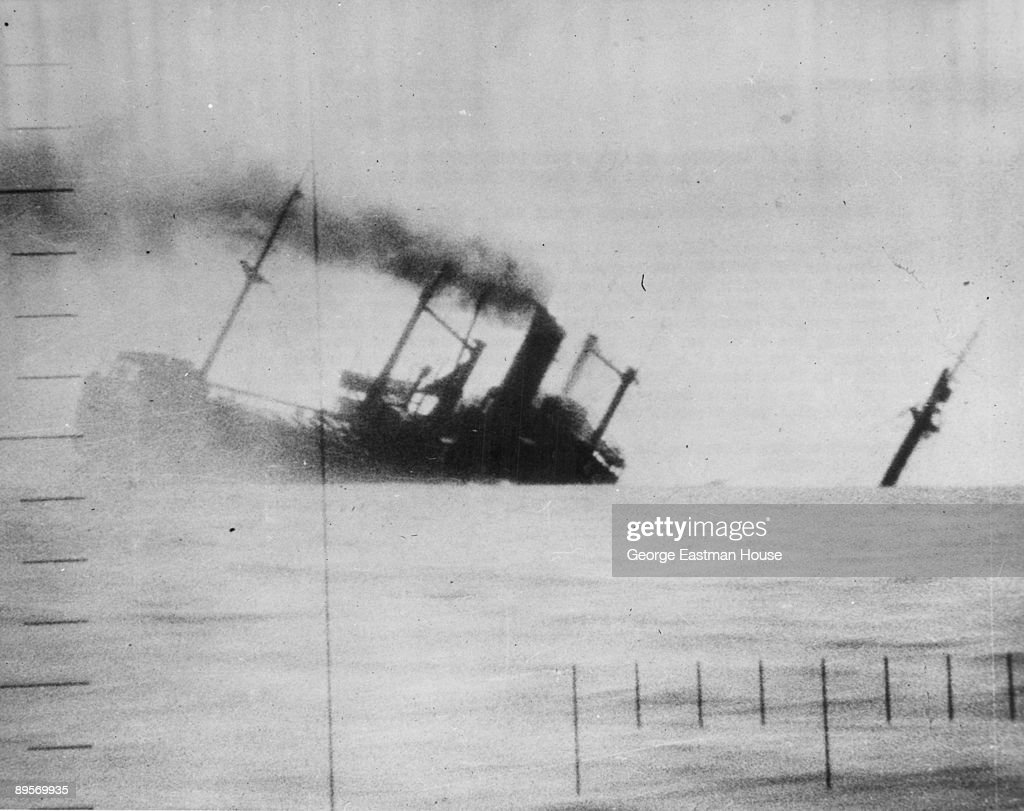View of a sinking Japanese ship, through the crosshairs of a periscope, as four U.S. submarines rescue Allied prisoners of war while sinking ten or more Japanese ships in the China Sea, August 11, 1945.