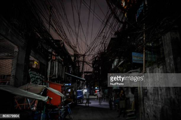 A view of a slum area at night where many killings have taken place in Caloocan north of Manila Philippines February 8 2017 Drugrelated killings...