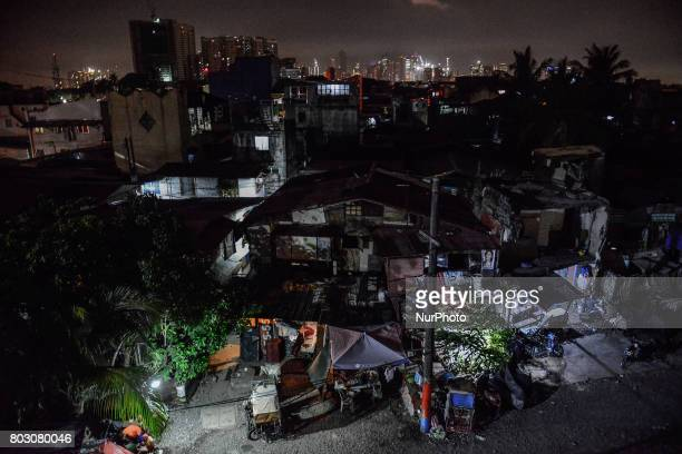 A view of a slum area at night where many killings have taken place in Manila Philippines June 6 2017 Drugrelated killings continue as President...