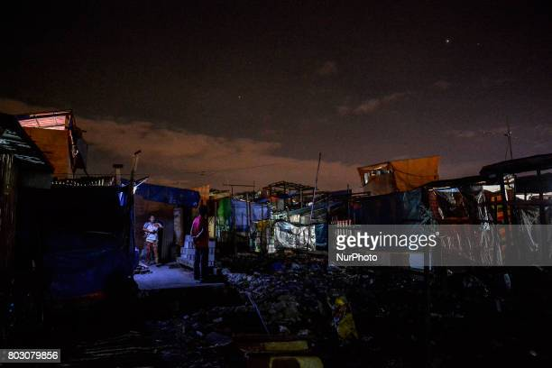 A view of a slum area inside a fishing port at night where many killings have taken place in Navotas north of Manila Philippines February 17 2017...