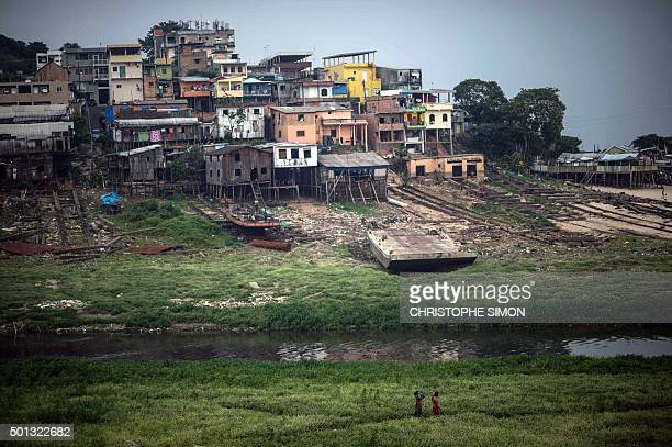 View of a slum on the bank of the Rio Negro in Manaus Amazonas state Brazil on December 11 2015 AFP PHOTO / Christophe SIMON / AFP / CHRISTOPHE SIMON