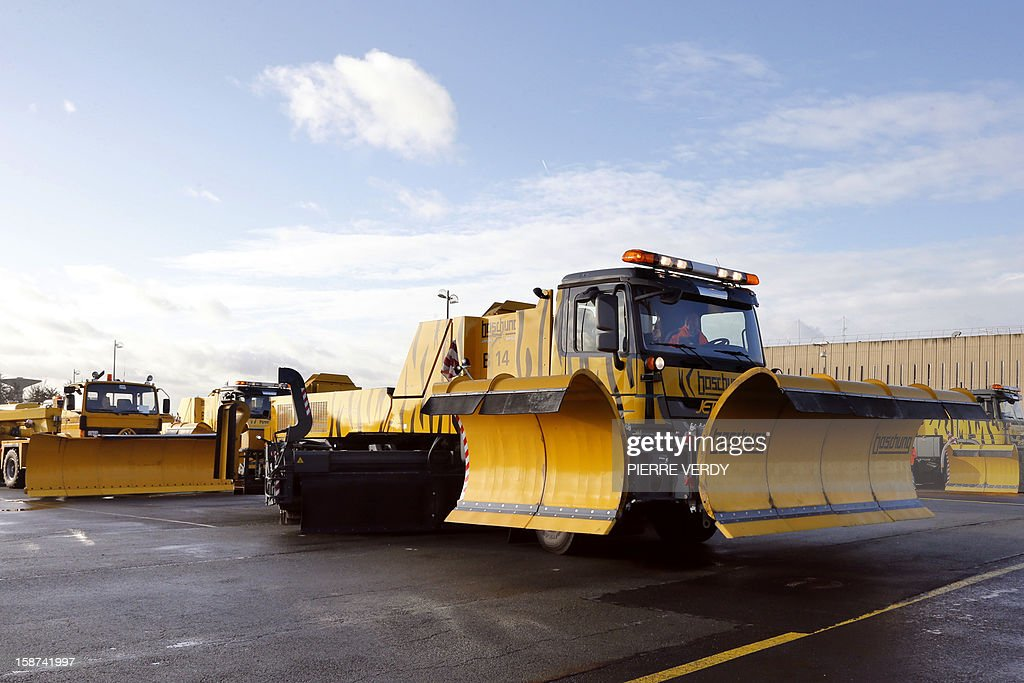 View of a snow plough at the Roissy-Charles de Gaulle airport, near Paris on December 27, 2012.