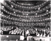 View of a sold out audience in their seats at the Metropolitan Opera House as seen from the stage New York New York 1940s The conductor can be seen...