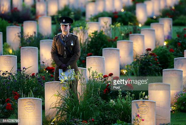 A view of a soldier amongst military graves illuminated during part of a militaryled vigil to commemorate the 100th anniversary of the beginning of...