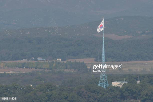 View of a South Korean flagpole from Dora Observatory near the Demilitarized Zone dividing two Koreas October 13 2017