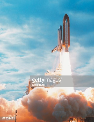 view of a space shuttle taking off from base