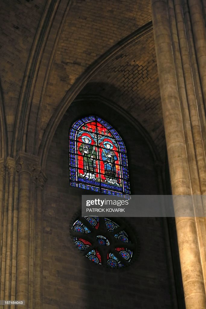A view of a stained glass window inside the Notre-Dame de Paris cathedral, on November 29, 2012, in Paris. AFP PHOTO / PATRICK KOVARIK