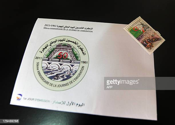 A view of a stamp and a printed envelope commemorating 50 years since the killing of around 200 people at a proAlgerian independence protest in Paris...