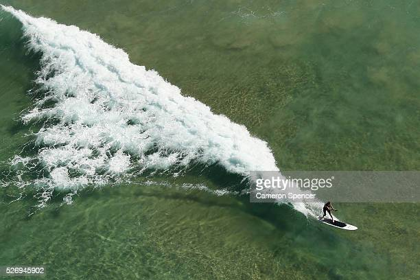 A view of a standup boarder riding a wave at Manly Beach from a blimp on April 28 2016 in Sydney Australia The Appliances Online blimp is the only...