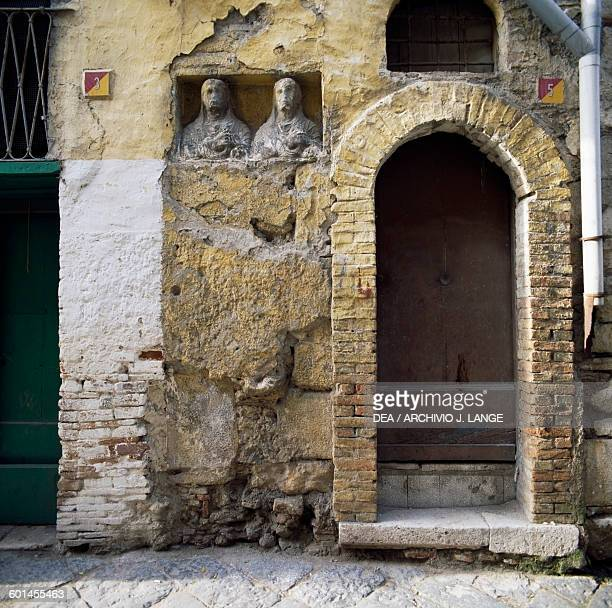 View of a street in Benevento with blocks of ancient buildings incorporated into the wall Benevento Campania Italy