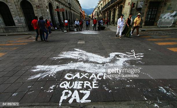 View of a street in downtown Oaxaca Mexico reading 'Oaxaca wants peace' on June 20 after a teachers protest Thousands of teachers protested in...