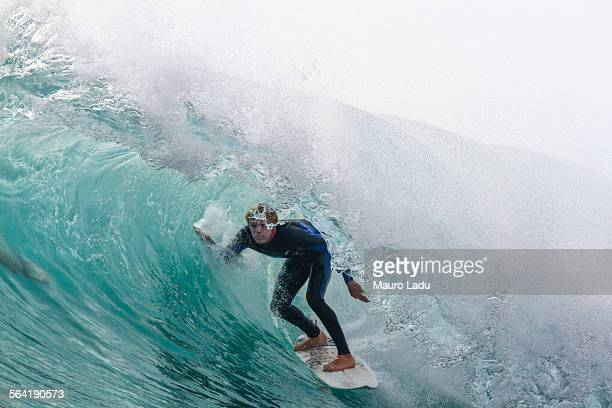View of a surfer inside a tube or barreling wave. Fuerteventura, Canary Islands