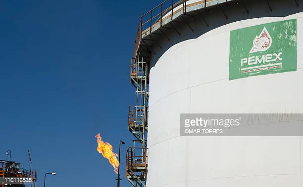 View of a tank with processed oil in front of a flame at Mexican stateowned petroleum company PEMEX refinery in Tula Hidalgo state Mexico on March 8...