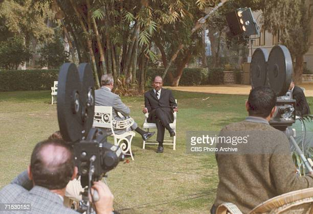 View of a television camera crew as they film an interview between American broadcast journalist Walter Cronkite and Egyptian President Anwar Sadat...