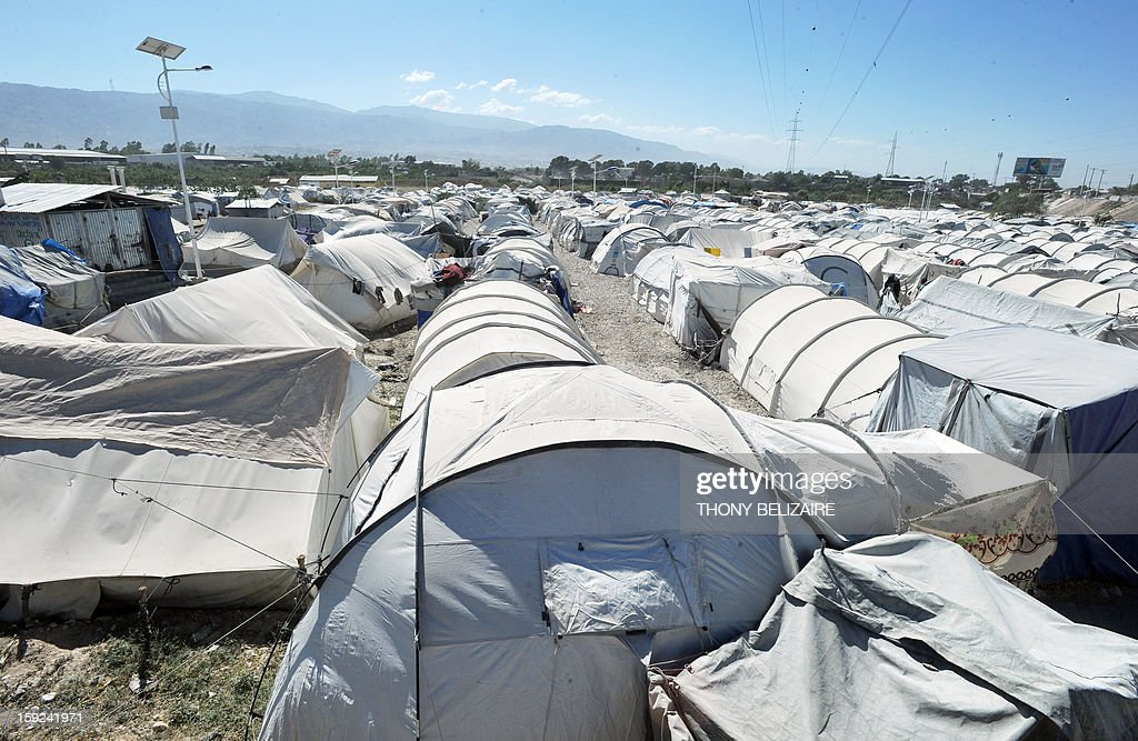 A view of a tent city is seen on January 8, 2013 in Marassa, a suburb of Port-au-Prince. Three years after the earthquake that devastated Haiti, 360,000 people are still living under tarps: among them, the inhabitants of the camps 'Marassa', located northeast of Port-au-Prince, who feel abandoned by everyone. About 750 families, or 5,000 people, coexist in these makeshift camps three 'Marassa' 9, 10 and 14, under the permanent threat of a large river that runs through the neighborhood. AFP PHOTO/ Thony BELIZAIRE