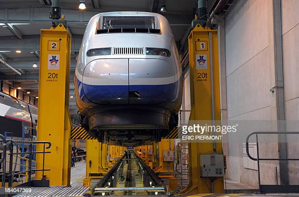 View of a TGV train on maintenance service at the technical centre of French national rail company SNCF the 'Technicentre SNCF Est Europeen' in...
