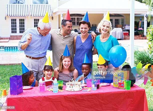 view of a three generational family celebrating a birthday