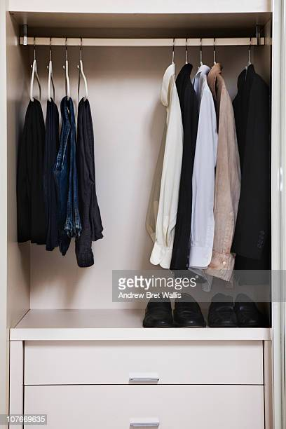 view of a tidy male wardrobe
