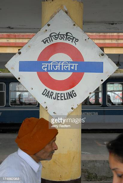 View of a train station sign in the Darjeeling station These days the train carries people on joy trips as most people and goods in the area now...