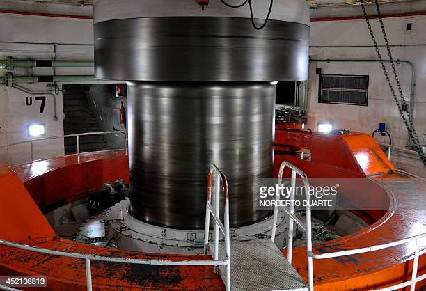 View of a turbine at the Itaipu hydroelectric dam on the Parana river Alto Parana in the ParaguayBrazil border on November 16 2013 AFP PHOTO /...