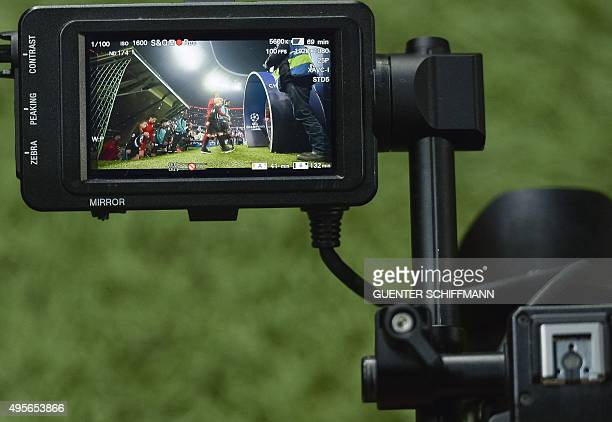 View of a tv camera screen as the teams walk out prior to the UEFA Champions League Group F secondleg football match between FC Bayern Munich and...