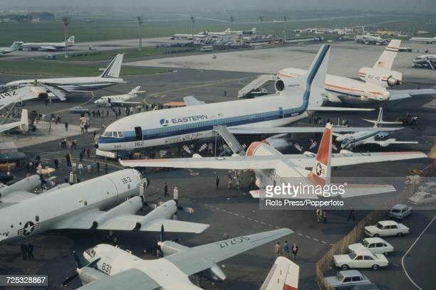 View of a United States built Lockheed L1011 TriStar threeengine wide body jet aircraft in Eastern Airlines livery surrounded by various other...