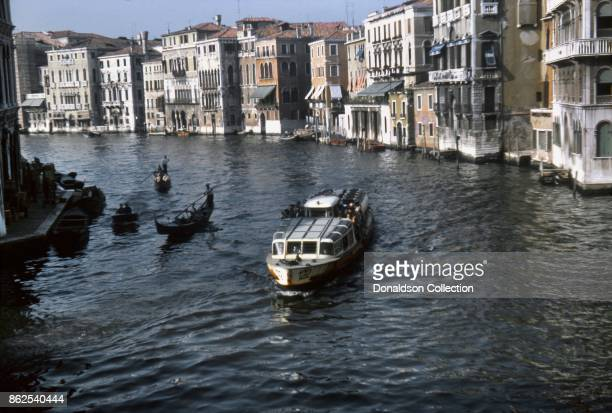 A view of a vaporetto and Gondolas on the Grand Canal on September 12 1963 in Venice Italy