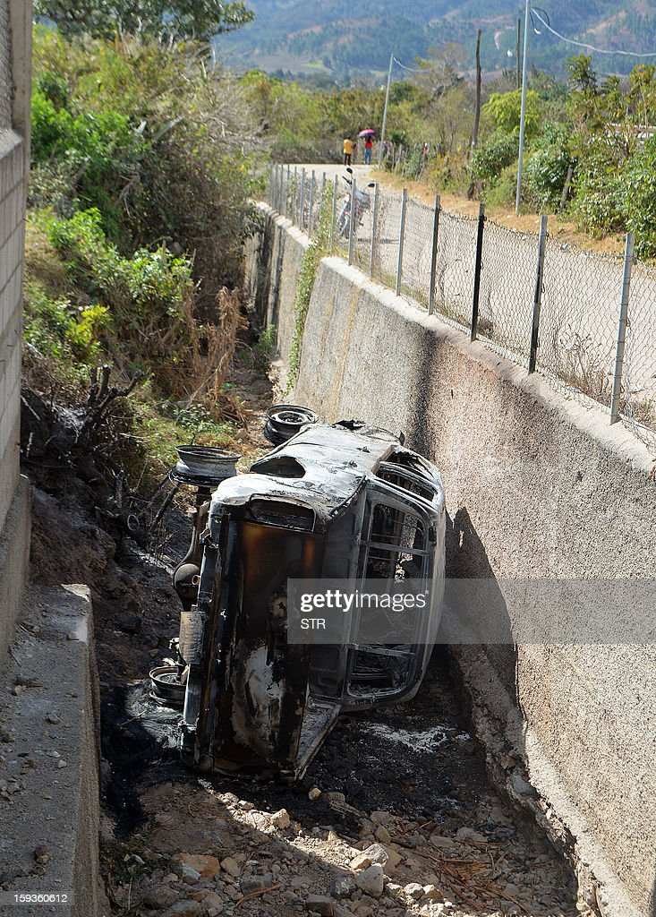 A view of a vehicle burned during a protest of neighbors against the exploitation of silver, where two were killed, in San Rafael Las Flores municipality, Jalapa departament, 105 km southeast of Guatemala City, on January 12, 2013. The two killed were security guards working for the San Rafael minery, a subsidiary of Canadian firm Tahoe Resources, said an official source.