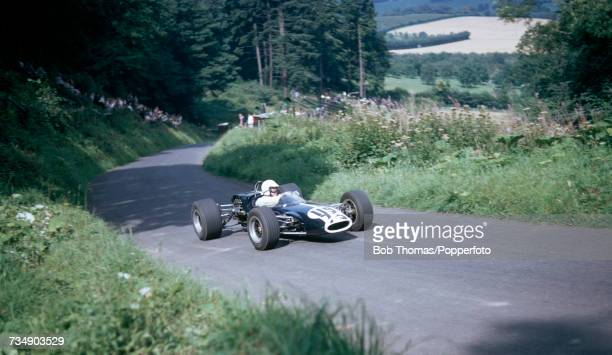 View of a vintage Lotus racing car being driven up hill on the course during a race organised by the Midland Automobile Club at the Shelsley Walsh...
