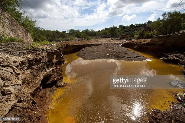 View of a water drain in the surroundings of the 'Buena Vista' copper mine in Cananea community Sonora state Mexico on August 13 from which five days...