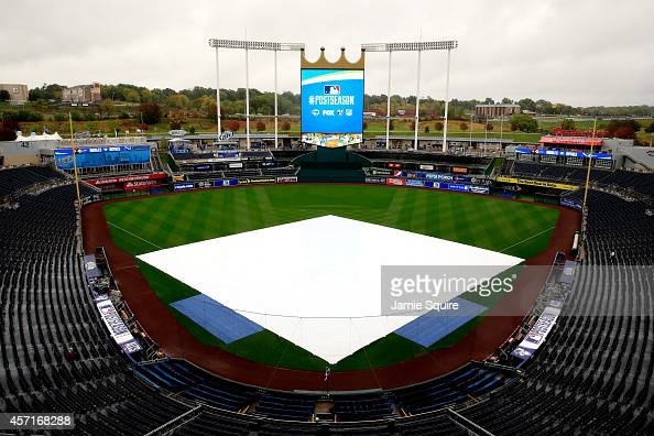 A view of a weather tarp covering the infield as rain falls to postpone Game Three of the American League Championship Series at Kauffman Stadium on...