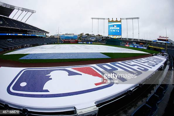 A view of a weather tarp covering the infield as rain falls to postpone Game Three of the American League Championship Series between the Baltimore...