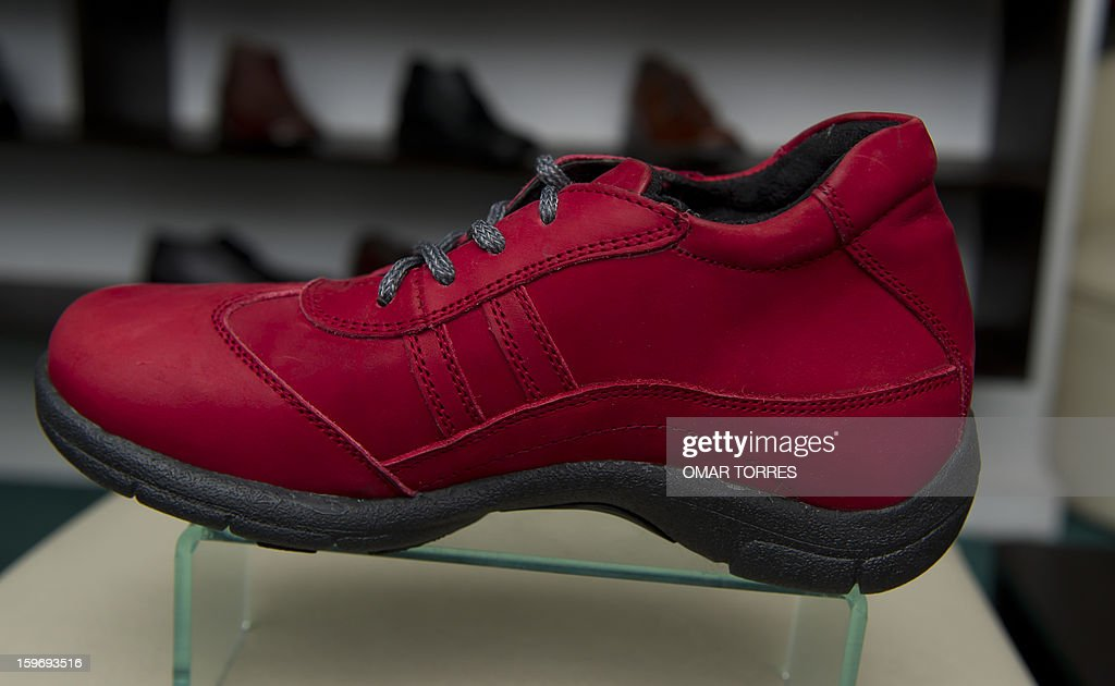View of a women shoe made with a hidden insole, to increase height, in a store in Mexico City on January 16, 2013. AFP PHOTO/ OMAR TORRES
