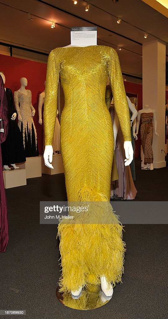 A view of a yellow beaded gown worn by Cyd Charisse at the press preview for Icons & Idols Fashion and Hollywood Exhibit at Julien's Auctions Gallery on November 5, 2013 in Los Angeles, California.