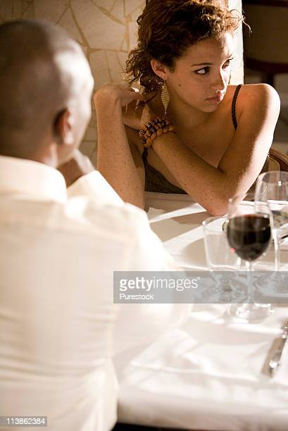 View of a young couple sitting at a restaurant table