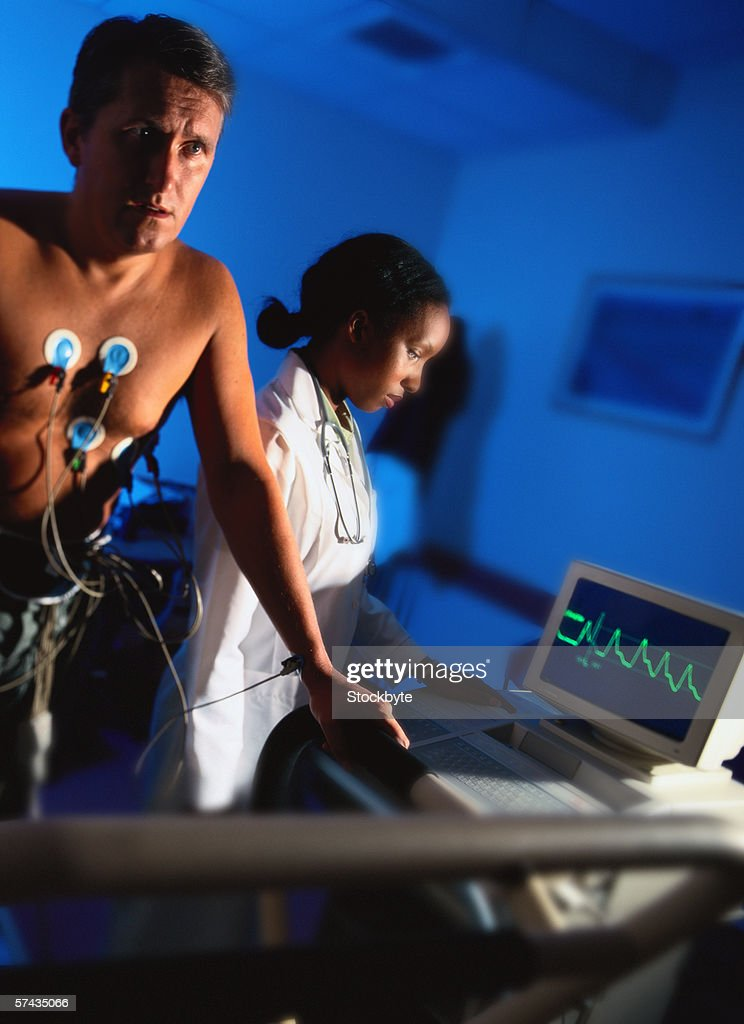 view of a young man getting a treadmill test done : Stock Photo