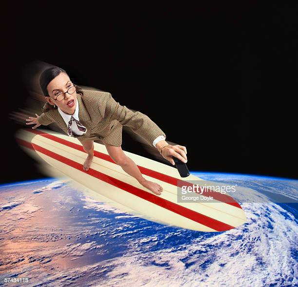 view of a young woman surfing around the earth