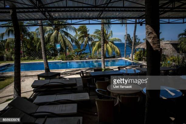 KARANGASEM BALI INDONESIA SEPTEMBER 30 A view of abandoned hotel as emptied of tourists at Tulamben beach on September 30 2017 in Karangasem regency...
