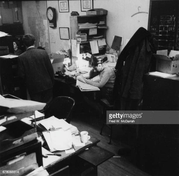 View of ad manager Della Brief and unidentified others at work in the offices of the Village Voice New York New York February 25 1960